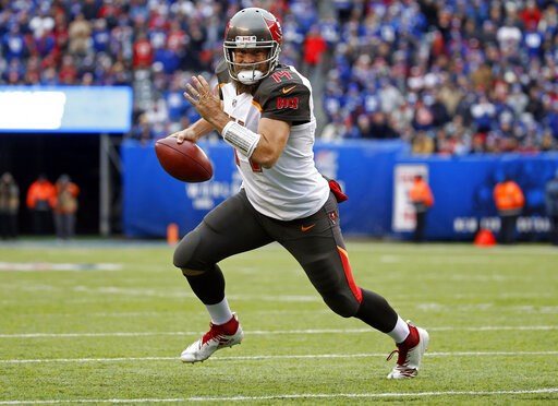 (AP Photo/Adam Hunger, File). FILE - In this Nov. 18, 2018, file photo, Tampa Bay Buccaneers quarterback Ryan Fitzpatrick (14) rushes for a touchdown against the New York Giants during an NFL football game in East Rutherford, N.J. Fitzpatrick has agree...