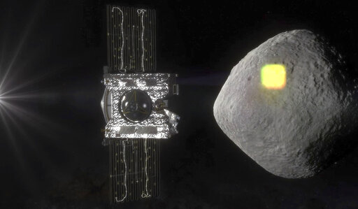 (NASA/Goddard/University of Arizona via AP). FILE - This artist's rendering made available by NASA in July 2016 shows the mapping of the near-Earth asteroid Bennu by the OSIRIS-REx spacecraft. Scientists had thought the asteroid Bennu had wide, open ar...