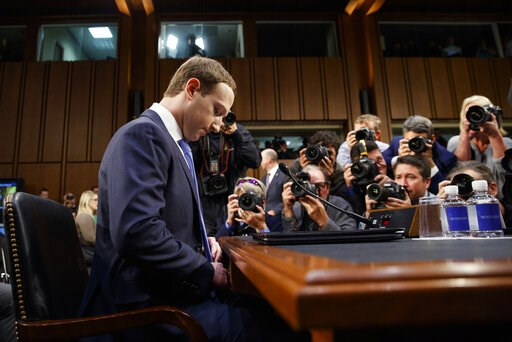 (AP Photo/Carolyn Kaster, File). FILE- In this April 10, 2018, file photo Facebook CEO Mark Zuckerberg adjusts his tie as he arrives to testify before a joint hearing of the Commerce and Judiciary Committees on Capitol Hill in Washington. Earlier this ...
