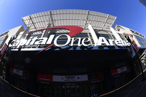 (AP Photo/Nick Wass). In this photograph taken with a fisheye lens, the exterior view of Capital One Arena is seen, Saturday, March 16, 2019, in Washington. As the NCAA prepares to stage its first basketball championships since the Supreme Court allowe...