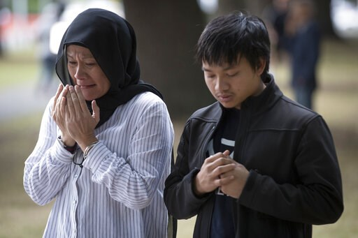 (AP Photo/Vincent Thian). Mourners react at a memorial site for victims in last week's mass shooting near the Al Noor mosque in Christchurch, New Zealand, Tuesday, March 19, 2019. Streets near the hospital that had been closed for four days reopened to...