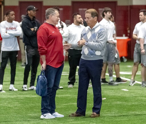 (AP Photo/Vasha Hunt). New England Patriots head coach Bill Belichick, left, talks with Alabama football coach Nick Saban at Alabama's NFL Pro Day, Tuesday, March 19, 2019, in Tuscaloosa, Ala.