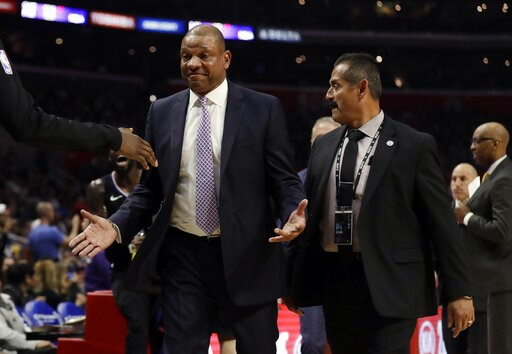 (AP Photo/Marcio Jose Sanchez). Los Angeles Clippers head coach Doc Rivers is escorted off the court after being ejected from an NBA basketball game against the Chicago Bulls Friday, March 15, 2019, in Los Angeles.