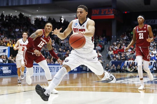 (AP Photo/John Minchillo). Belmont's Kevin McClain drives to the net during the first half of a First Four game of the NCAA college basketball tournament against Temple, Tuesday, March 19, 2019, in Dayton, Ohio.