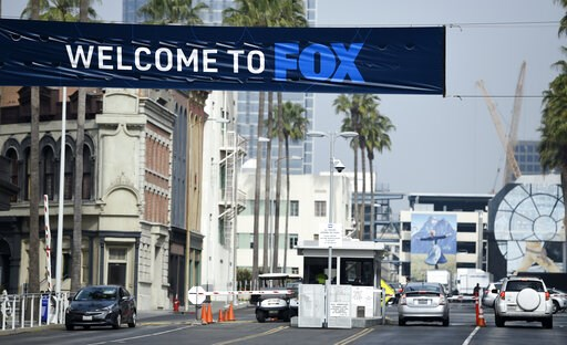 (AP Photo/Chris Pizzello). Cars enter and leave Fox Studios, Tuesday, March 19, 2019, in Los Angeles. Disney has closed its $71 acquisition of Fox's entertainment business on Wednesday, March 20, in a move set to shake up the media landscape. The closu...