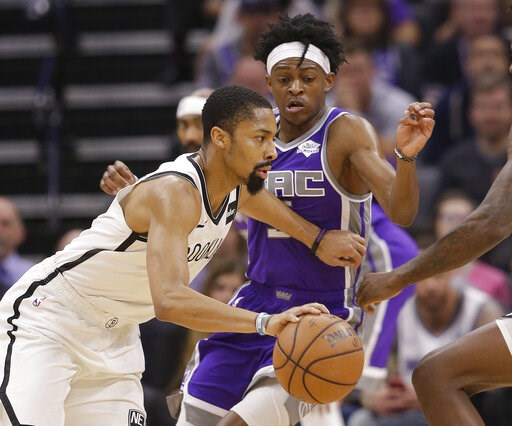 (AP Photo/Rich Pedroncelli). Brooklyn Nets guard Spencer Dinwiddie, left, drives against Sacramento Kings guard De'Aaron Fox, right, during the first quarter of an NBA basketball game Tuesday, March 19, 2019, in Sacramento, Calif.