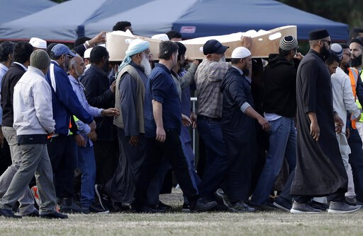 (AP Photo/Mark Baker). Mourners carry the body of a victim of the Friday, March 15, mosque shootings for burial at the Memorial Park Cemetery in Christchurch, New Zealand, Wednesday, March 20, 2019. New Zealand Police Commissioner Mike Bush says he bel...
