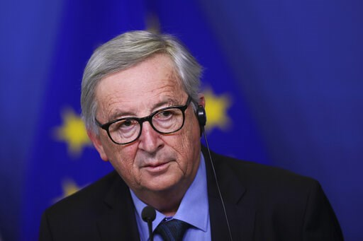(AP Photo/Francisco Seco). European Commission President Jean-Claude Juncker listens to a question during a joint press conference with Slovakian President Andrej Kiska at the European Commission headquarters in Brussels, Tuesday, March 19, 2019. The B...