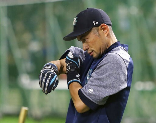 (AP Photo/Toru Takahashi). Seattle Mariners right fielder Ichiro Suzuki wipes his sweat during the team's batting practice prior to Game 1 of a Major League opening series baseball game against the Oakland Athletics at Tokyo Dome in Tokyo, Wednesday, M...
