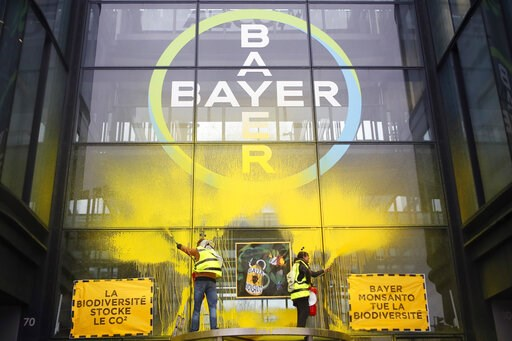 (AP Photo/Francois Mori). French activists of Attac spray-paint the Paris headquarters of Bayer AG to protest its production of environment-damaging pesticides in la Garenne Colombes, suburb of Paris, Thursday, March 14, 2019. Germany-based Bayer is al...
