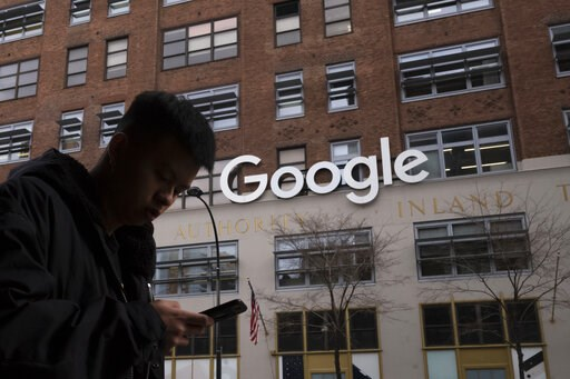 (AP Photo/Mark Lennihan, File). FILE - In this Dec. 17, 2018, file photo a man using a mobile phone walks past Google offices in New York. Google says it plans to launch a video-game streaming platform called Stadia, positioning itself to take on the t...