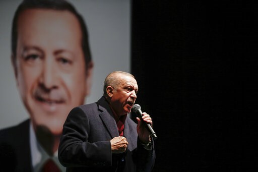 (AP Photo/Emrah Gurel). Turkey's President Recep Tayyip Erdogan addresses the supporters of his ruling Justice and Development Party, AKP, at a rally in Istanbul, late Tuesday, March 19, 2019, ahead of local elections scheduled for March 31, 2019.