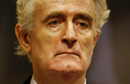 (Jerry Lampen/Pool via AP, File). FILE - In this Thursday July 31, 2008 file photo, former Bosnian Serb leader Radovan Karadzic stands in the courtroom during his initial appearance at the U.N.'s Yugoslav war crimes tribunal in The Hague, Netherlands. ...