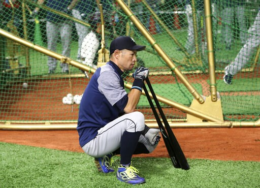 (AP Photo/Koji Sasahara). Seattle Mariners right fielder Ichiro Suzuki waits for batting prior to Game 1 of a Major League opening series baseball game against the Oakland Athletics at Tokyo Dome in Tokyo, Wednesday, March 20, 2019.