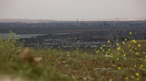 (AP Photo/Maya Alleruzzo). In this Sunday, March 17, 2019, photo, the Islamic State group's last pocket of territory in Baghouz, Syria, as seen from a distance. On Tuesday, a spokesman for U.S.-backed forces fighting IS in Syria says his fighters are i...