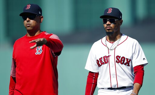 (AP Photo/Michael Dwyer, File). FILE - In this Sept. 16, 2018, file photo, Boston Red Sox manager Alex Cora, left, escorts Mookie Betts off the field during the sixth inning of the team's baseball game against the New York Mets in Boston. Betts drove i...
