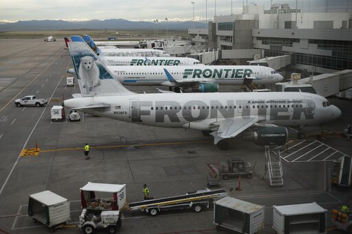 (AP Photo/David Zalubowski, File). FILE - In this May 15, 2017 file photo, Frontier Airlines jetliners sit at gates at Denver International Airport. The union representing Frontier Airlines flight attendants says they have reached a tentative contract ...