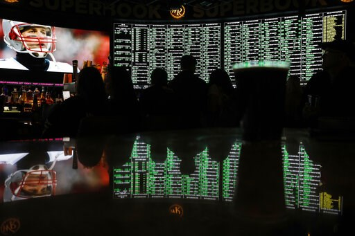 (AP Photo/John Locher, File). FILE - In this Feb. 3, 2019 file photo, Prop bets for Super Bowl LIII are on display before the start of the game at the Westgate Superbook sports book in Las Vegas. About six in 10 Americans want betting on professional s...