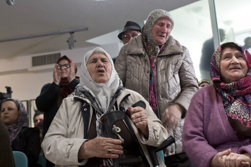 (AP Photo/Marko Drobnjakovic). Relatives of victims of the Srebrenica genocide weep as they hear news on the decision of the UN appeals judges on former Bosnian Serb leader Radovan Karadzic in Potocari, Bosnia and Herzegovina, Wednesday, March 20, 2019...