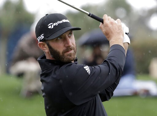 (AP Photo/Lynne Sladky). Dustin Johnson plays his shot from the third tee during the final round of The Players Championship golf tournament Sunday, March 17, 2019, in Ponte Vedra Beach, Fla.