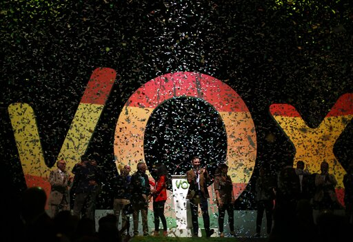 (AP Photo/Manu Fernandez, File). FILE - In this Sunday, Oct. 7, 2018 file photo, Santiago Abascal the national president of VOX, center, applauds during a rally of the fledgling far-right party VOX in Madrid, Spain. The far-right party is making politi...