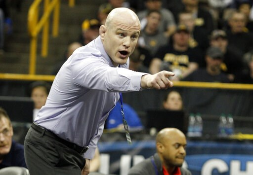 (AP Photo/Matthew Holst, File). FILE - In this March 5, 2016, file photo, Penn State's Cael Sanderson yells during a 141 pound weight class match during the Big Ten Wrestling Championships in Iowa City, Iowa. Penn State is poised to send out another se...