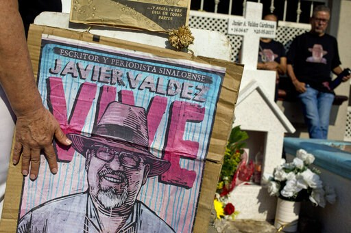 (AP Photo/Enric Marti, File). FILE - In this July 1, 2017 file photo, relatives of slain journalist Javier Valdez, co-founder of Riodoce, stand at a memorial set up at the spot where he was murdered in Culiacan, Sinaloa state, Mexico. Valdez's widow wa...