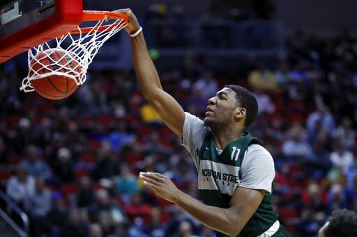 (AP Photo/Charlie Neibergall). Michigan State forward Aaron Henry dunks the ball during practice at the NCAA men's college basketball tournament, Wednesday, March 20, 2019, in Des Moines, Iowa. Michigan State plays Bradley on Thursday.