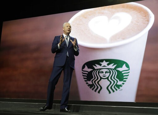 (AP Photo/Ted S. Warren). Starbucks CEO Kevin Johnson speaks Wednesday, March 20, 2019, at the company's annual shareholders meeting in Seattle.