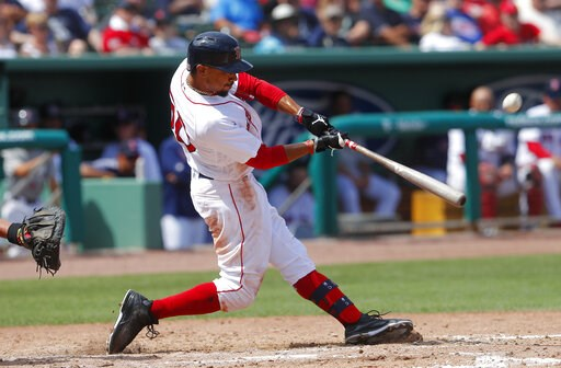 (AP Photo/John Bazemore). Boston Red Sox' Mookie Betts connects on a solo-home run in the seventh inning of a spring training baseball game against the Atlanta Braves Saturday, March 16, 2019, in Fort Myers, Fla.