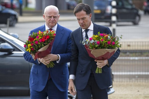 (AP Photo/Peter Dejong). Dutch Prime Minister Mark Rutte, right, and Justice Minister Ferd Grapperhaus arrive at a makeshift memorial for victims of a shooting incident in a tram in Utrecht, Netherlands, Tuesday, March 19, 2019. A gunman killed three p...