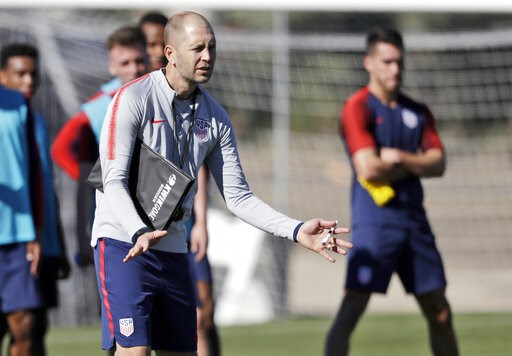 (AP Photo/Marcio Jose Sanchez, File). FILE - In this Jan. 7, 2019, file photo, United States head coach Gregg Berhalter instructs players during a soccer training camp in Chula Vista, Calif. Berhalter prepares for U.S. national team matches like a busi...