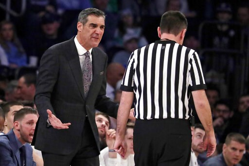 (AP Photo/Julio Cortez). Villanova head coach Jay Wright, left, talks to referee Pat Driscoll during the first half of an NCAA college basketball game against Seton Hall in the championship of the Big East Conference tournament, Saturday, March 16, 201...