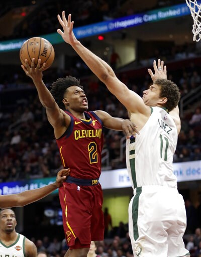 (AP Photo/Tony Dejak). Cleveland Cavaliers' Collin Sexton (2) drives to the basket against Milwaukee Bucks' Brook Lopez (11) during the first half of an NBA basketball game Wednesday, March 20, 2019, in Cleveland.
