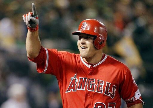 (AP Photo/Ben Margot, File). FIEL - In this April 3, 2017, file photo, Los Angeles Angels' Mike Trout celebrates after hitting a two-run home run off Oakland Athletics' Kendall Graveman in the third inning of a baseball game in Oakland, Calif. A person...