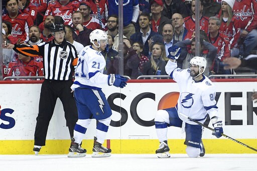 (AP Photo/Nick Wass). Tampa Bay Lightning right wing Nikita Kucherov, right, of Russia, celebrates his goal with center Brayden Point (21) during the second period of an NHL hockey game against the Washington Capitals, Wednesday, March 20, 2019, in Was...
