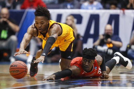 (AP Photo/John Minchillo). Arizona State's Kimani Lawrence, left, and St. John's Sedee Keita, right, dive for a loose ball during the first half of a First Four game of the NCAA men's college basketball tournament, Wednesday, March 20, 2019, in Dayton,...