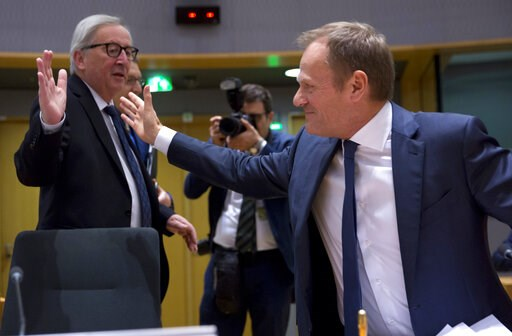 (AP Photo/Virginia Mayo). European Commission President Jean-Claude Juncker, left, greets European Council President Donald Tusk during a tripartite social summit at the Europa building in Brussels, Wednesday, March 20, 2019. European Union officials r...