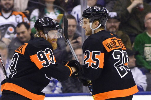 (Frank Gunn/The Canadian Press via AP). Philadelphia Flyers right wing Jakub Voracek (93) celebrates his goal with James van Riemsdyk (25) during the first period of an NHL hockey game against the Toronto Maple Leafs on Friday, March 15, 2019, in Toron...