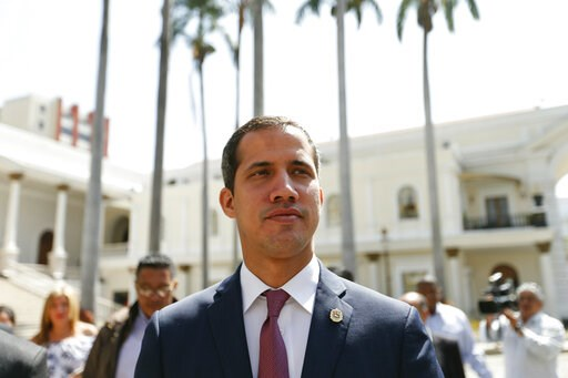 "(AP Photo/Natacha Pisarenko). Venezuelan opposition leader Juan Guaido, who has declared himself interim president, arrives to the National Assembly for a meeting with ""Frente Amplio,"" a coalition of opposition parties, and other civic groups in Caraca..."