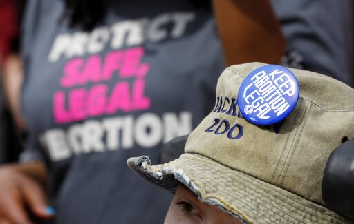 (AP Photo/Rogelio V. Solis, File). FILE -  In this March 14, 2019 file photograph, a Planned Parenthood supporter hosts an abortion rights button on her hat during a rally on the steps of the Capitol in Jackson, Miss. On Tuesday, March 19, 2019, Missis...