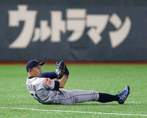(AP Photo/Toru Takahashi). Seattle Mariners right fielder Ichiro Suzuki stretches on the field prior to Game 2 of the Major League baseball opening series between the Mariners and the Oakland Athletics at Tokyo Dome in Tokyo, Thursday, March 21, 2019. ...