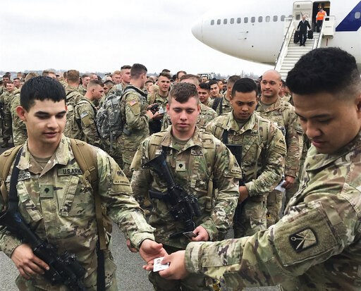 (AP Photo/Dorothee Thiesing). Soldiers from the 1st Armored Division, based in Fort Bliss, Texas, arrives at the airport Tegel in Berlin, Thursday, March 21, 2019. Over three hundred soldiers have arrived in Germany from their base in Texas in the firs...