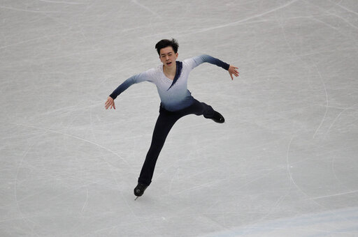 (AP Photo/Andy Wong). Vincent Zhou from the U.S. performs his men's short program routine during the ISU World Figure Skating Championships at Saitama Super Arena in Saitama, north of Tokyo, Thursday, March 21, 2019.