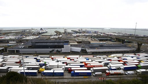 (Gareth Fuller/PA via AP, file). FILE - In this Tuesday March 12, 2019 file photo, lorries queue at the entrance to the Port of Dover ferry terminal during delays to the cross Channel ferry, in Dover, England. Britain unveiled a temporary tariff regime...
