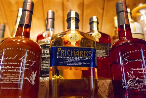 (AP Photo/Erik Schelzig). FILE - In this March 19, 2015 file photo, bottles of spirits are on display at the Prichard's Distillery in Nashville, Tenn. A spirits industry trade group says the tariff-induced hangover for American whiskey producers became...