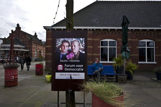 (AP Photo/Muhammed Muheisen). -FILE- In this Sunday, March 5, 2017 photo, a damaged election poster showing, left, Thierry Baudet and Theo Hiddema, from the Forum for Democracy party, FVD, is displayed in a park in Amsterdam, Netherlands. The Netherlan...