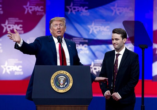 (AP Photo/Jose Luis Magana). In this March 2, 2019 photo, President Donald Trump invites to the podium, Hayden Williams, a field representative of the Leadership Institute, who was assaulted at Berkeley campus, at the Conservative Political Action Conf...