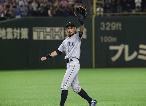 (AP Photo/Koji Sasahara). Seattle Mariners right fielder Ichiro Suzuki waves to spectators while leaving the field for defensive substitution in the eighth inning of Game 2 of the Major League baseball opening series against the Oakland Athletics at To...