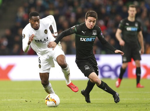 (AP Photo/Vitaliy Timkiv). Valencia's Geoffrey Kondogbia, left, and Krasnodar's Mauricio Pereyra challenge for the ball during the Europa League round of 16, second leg soccer match between FC Krasnodar and Valencia at the Krasnodar Stadium in Krasnoda...